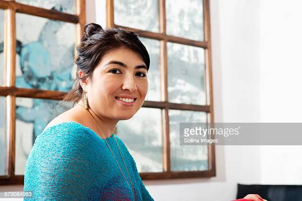 Hispanic woman smiling in cafe