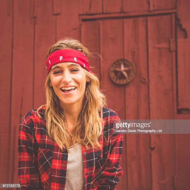 hispanic woman smiling near red wooden door - headband stock pictures, royalty-free photos & images