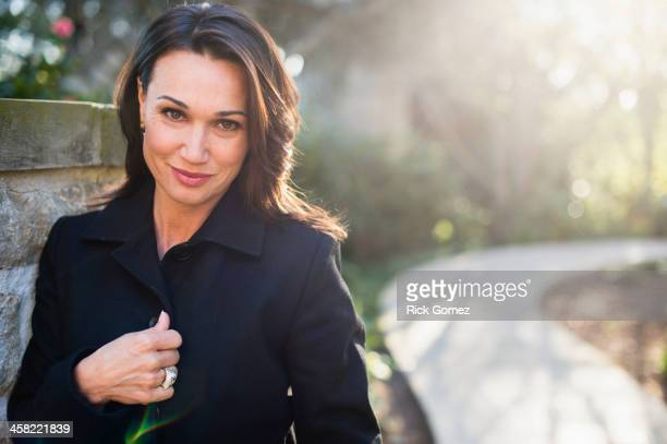hispanic woman smiling - coat stock pictures, royalty-free photos & images
