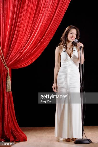 hispanic woman speaking on stage - beauty contest stock pictures, royalty-free photos & images