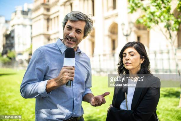 hispanic woman speaking to media - media interview stock pictures, royalty-free photos & images
