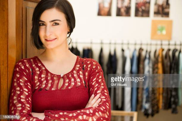 Hispanic woman standing in clothing store