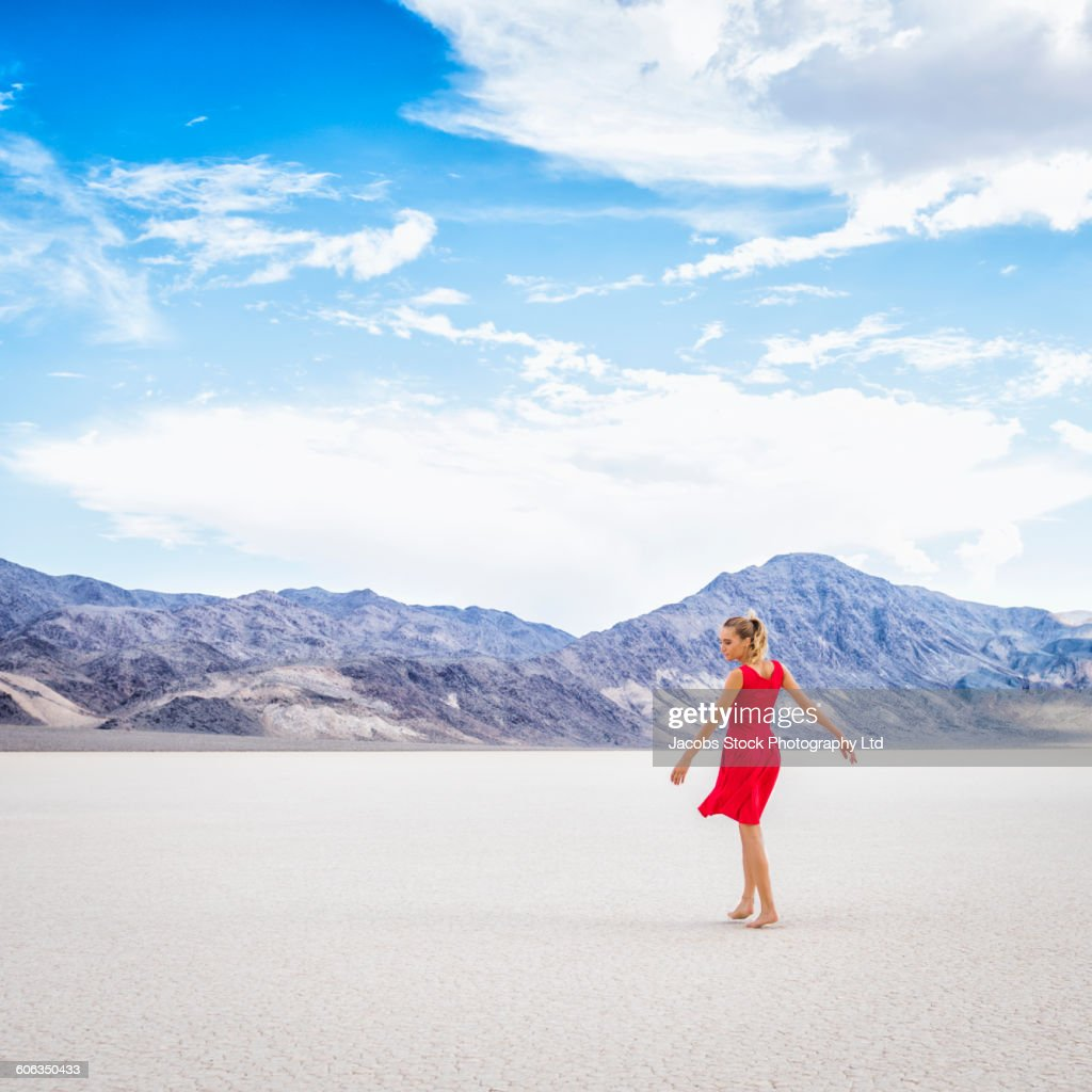 Hispanic woman standing in remote desert : Stock Photo