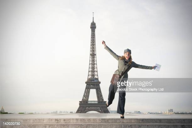 Hispanic woman standing near the Eiffel Tower
