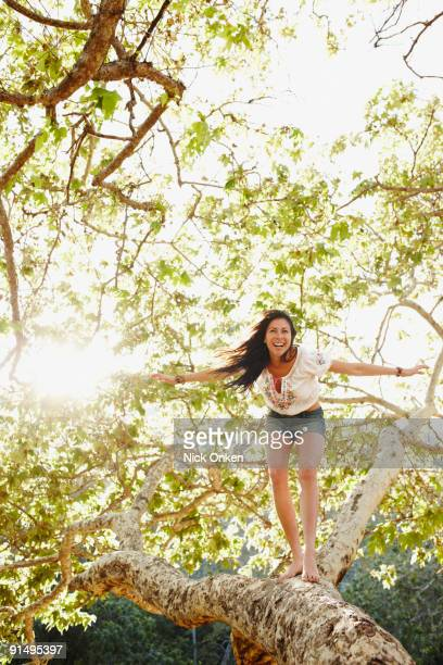 hispanic woman standing on tree branch - limb body part stock pictures, royalty-free photos & images