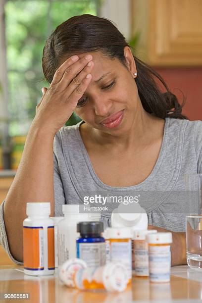 Hispanic woman suffering from a headache