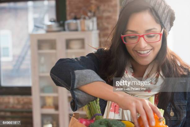 Hispanic woman unpacking groceries