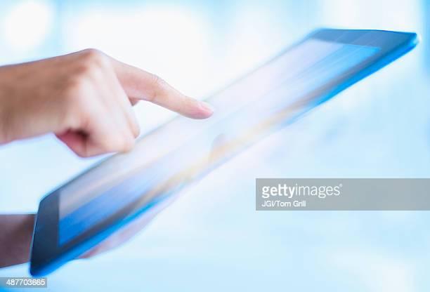Hispanic woman using digital tablet