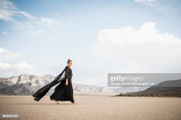 Hispanic woman walking in remote desert