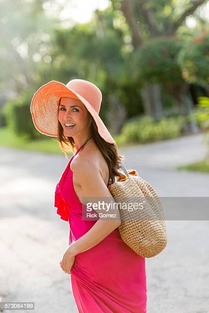 Hispanic woman walking on road