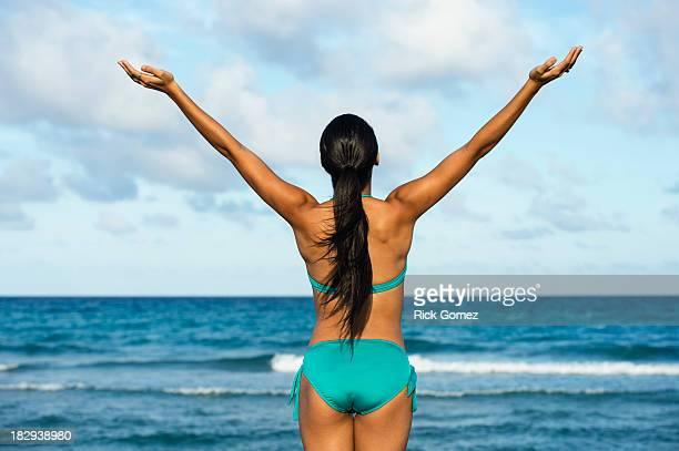 hispanic woman wearing bikini on beach - dominican ethnicity stock photos and pictures