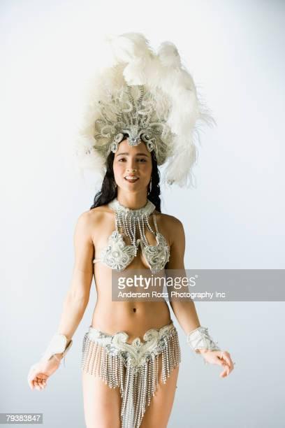 Hispanic woman wearing carnival costume