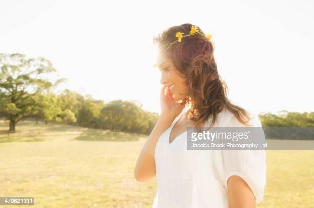 Hispanic woman wearing flower crown outdoors