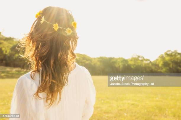 Hispanic woman wearing flower crown outdoors