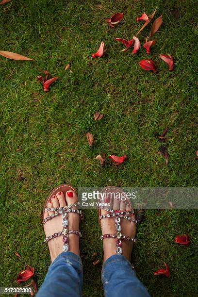 Hispanic woman wearing sandals