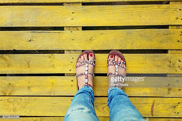 Hispanic woman wearing sandals