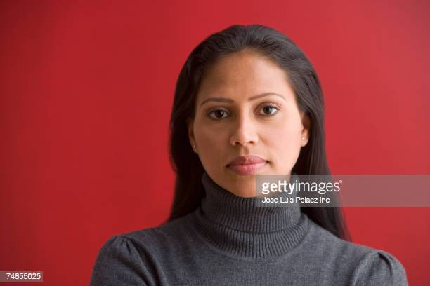 Hispanic woman wearing sweater