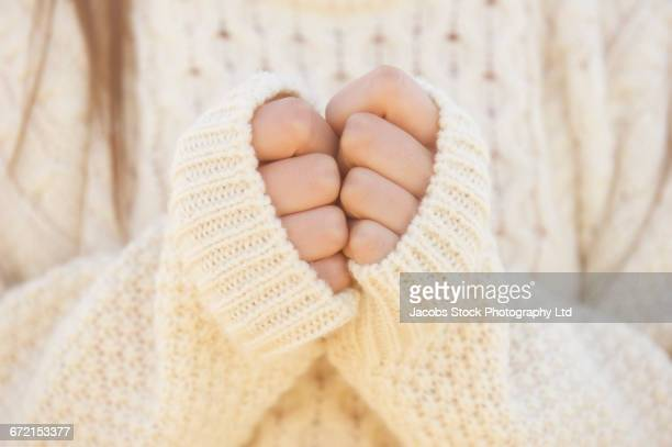 hispanic woman wearing sweater with hands clasped - セーター ストックフォトと画像