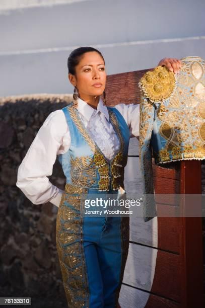 Hispanic woman wearing toreador outfit