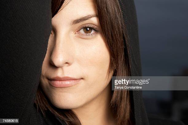 Hispanic woman with arm over eye