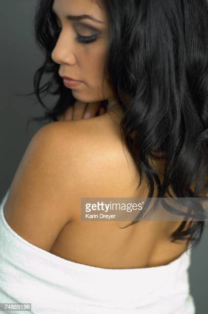 hispanic woman with bare shoulders - off shoulder stock pictures, royalty-free photos & images