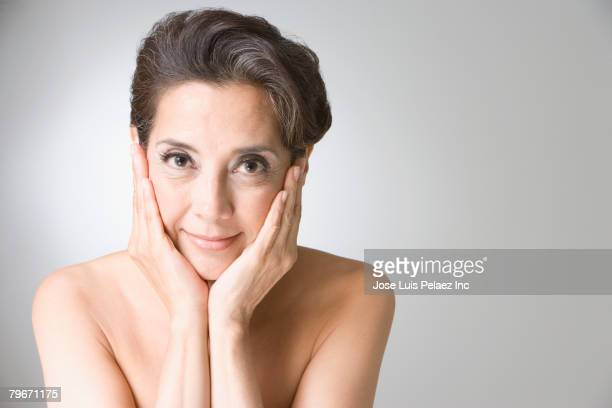 Hispanic woman with hands on face