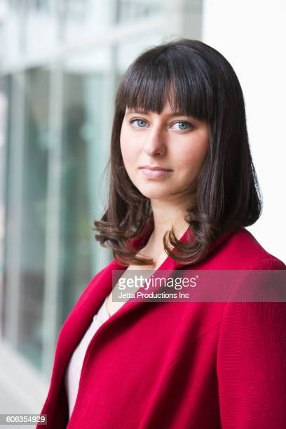 Hispanic woman with serious expression