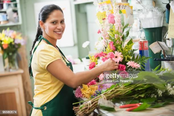 Hispanic woman working in florist shop