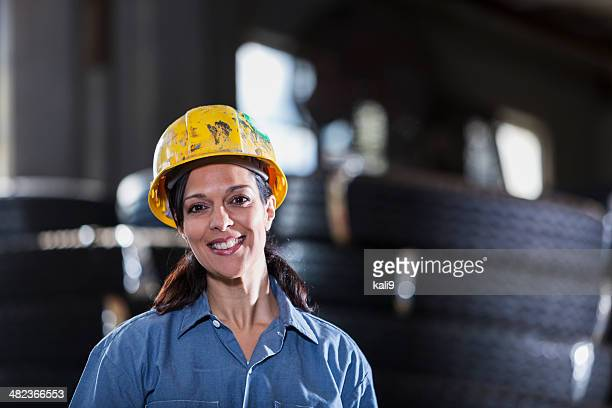 Hispanic woman working in warehouse