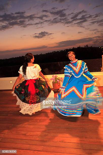 Hispanic Women Dancing In Traditional Folkloric Dresses Guaycura Boutique Hotel And Spa; Todos Santos Baja California Mexico