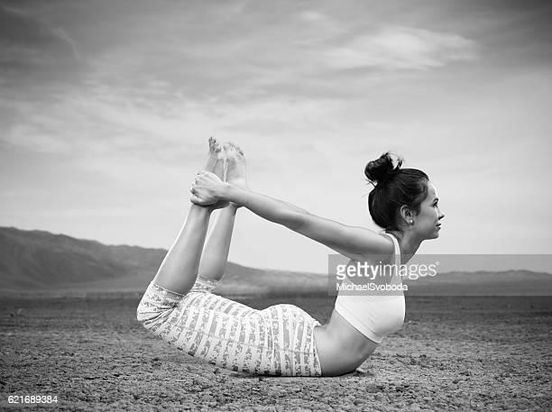 Hispanic Women Doing Yoga In The Desert