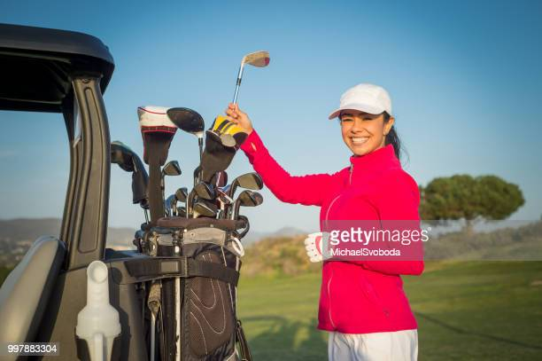 hispanic women golfer getting a club - golfer stock pictures, royalty-free photos & images