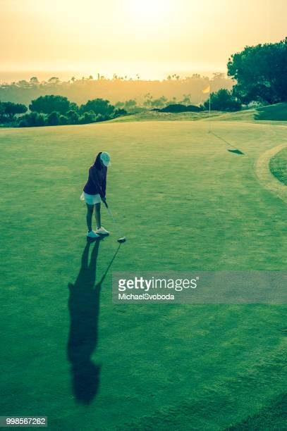 hispanic women golfer - cross processed stock pictures, royalty-free photos & images