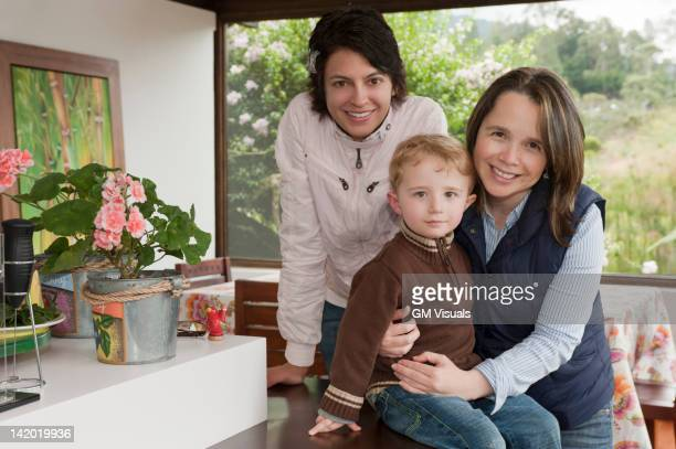 hispanic women hugging boy on porch - zia e nipote foto e immagini stock