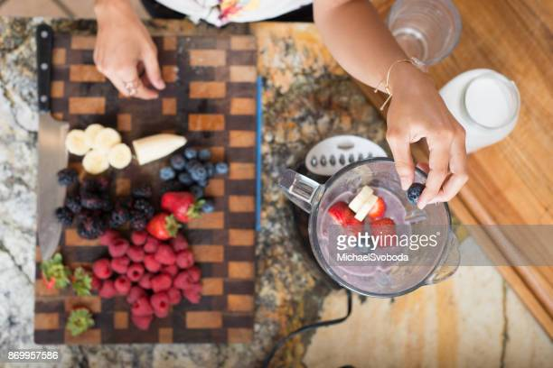 Hispanic Women In The Kitchen Making Smoothies