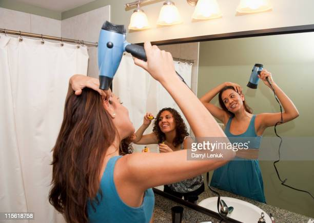Hispanic women preparing for girl's night out