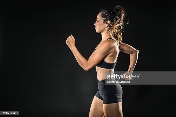 Hispanic Women Runner On A Black Background