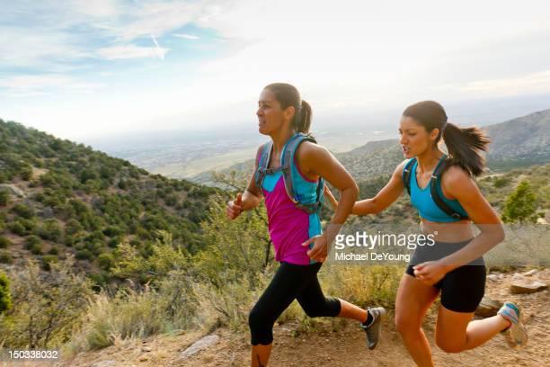 Hispanic women running in remote area