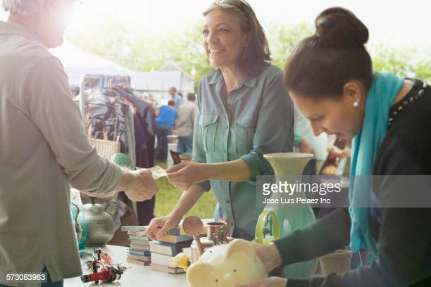 hispanic women shopping at flea market - flea market stock pictures, royalty-free photos & images