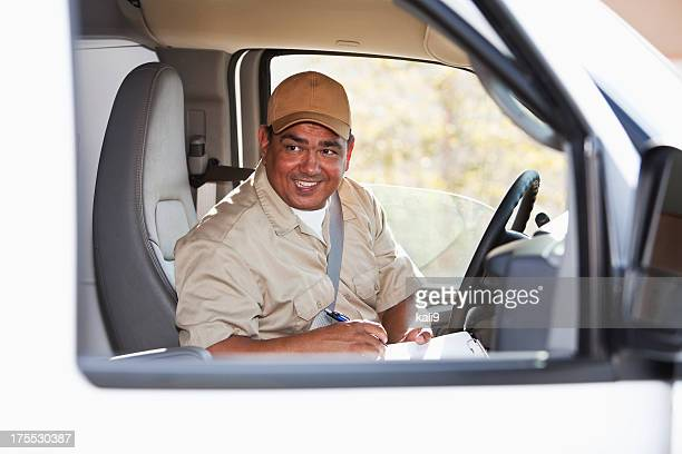 Hispanic worker driving van