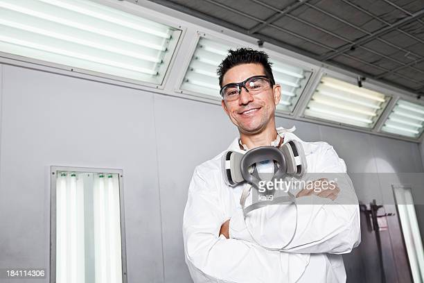 Hispanic worker in auto body shop