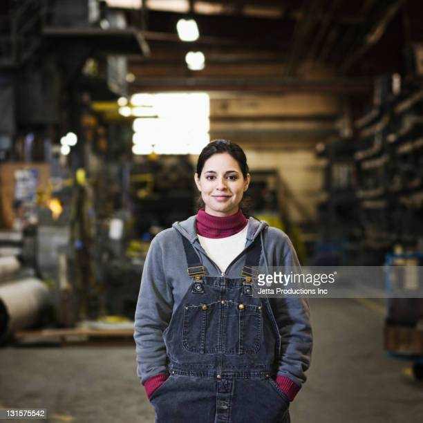 Hispanic worker standing in factory