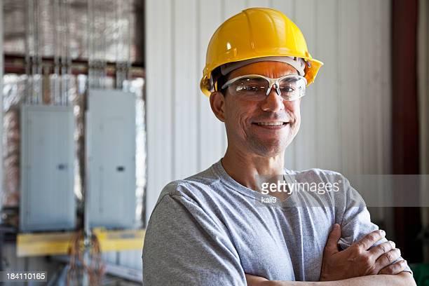 Hispanic worker wearing hard hat