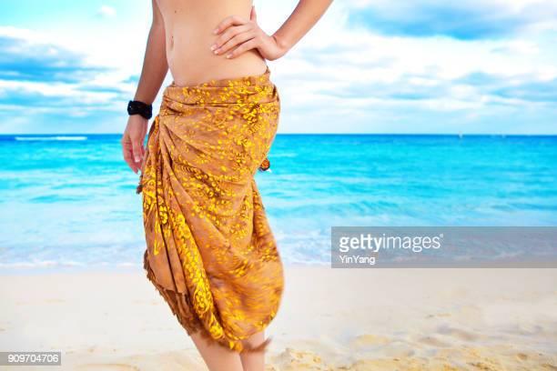 Hispanic Young Woman in Swimsuit Bikini Vacationing in Beach in Cancun Mexico
