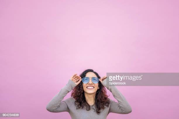 hispanic young woman with positive attitude - women's issues stock photos and pictures