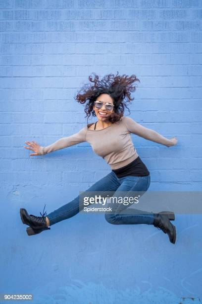 hispanic young woman with positive attitude - trousers stock pictures, royalty-free photos & images
