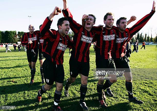 Histon players Erkan Okay Neil Kennedy Jamie Barker and Louie Farrington celebrate their 20 win over Shrewsbury during the FA Cup first round match...