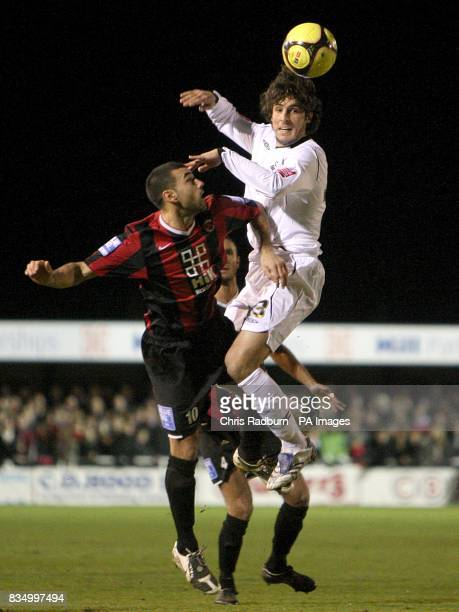 Histon's Antonio Murray and Swansea City's Guillem Bauza battle for the ball