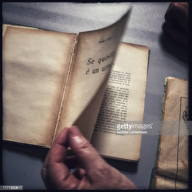 A historian flips through a first printing of author Primo Levi's If This Is A Man published in 1947 and later republished under the more all known...