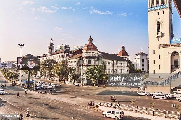 historic building by city street against sky - yangon stock pictures, royalty-free photos & images